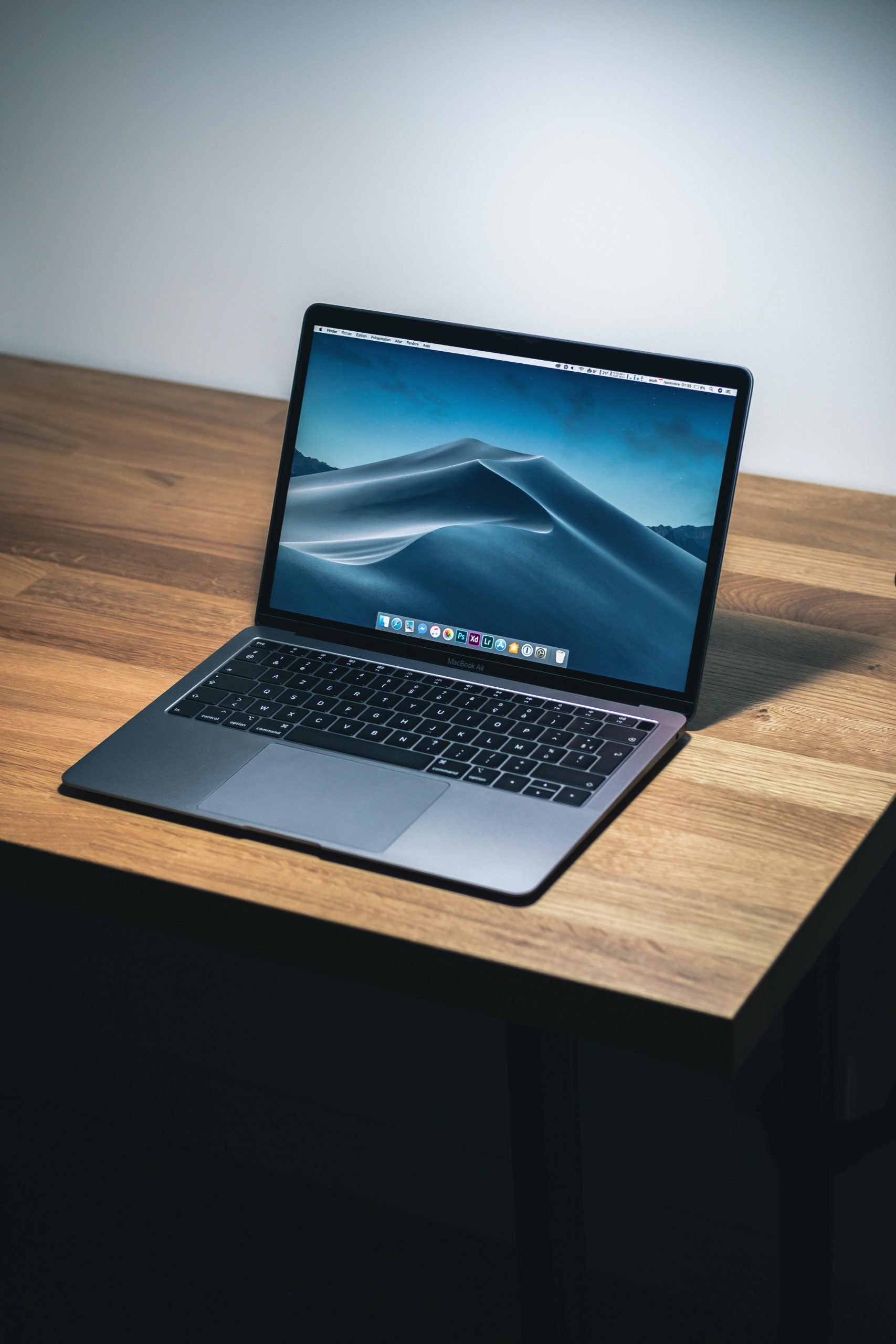 Laptop on desk with mountain